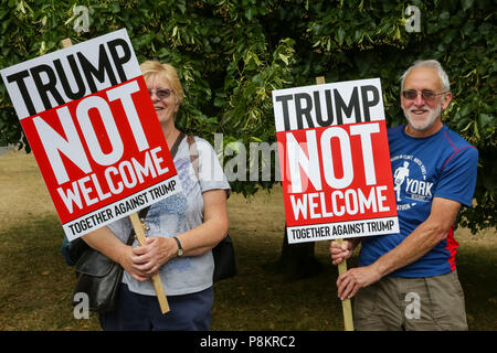 Regent's Park London, 12th July 2018. Demonstrators are protesting against US President Donald Trump's visit to London at Hanover Gate, close to Winfield House, the US ambassador's residence where Trump is expected to spend some time today. Credit: Imageplotter News and Sports/Alamy Live News - Stock Image