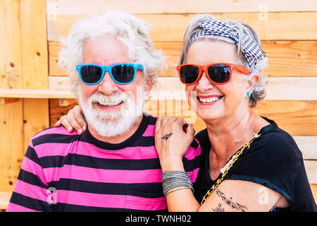 Nice and young senior active couple together in love and friendship in front of the camera - no limit age for modern retired lifestyle people - cheerf - Stock Image