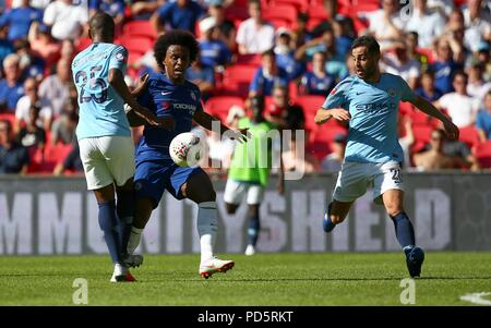 Fernandinho of Manchester City is challenged by Chelsea's Willian the FA Community Shield match between Chelsea and Manchester City at Wembley Stadium in London. 05 Aug 2018 - Stock Image