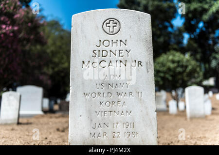 Headstone of U.S. Navy Adm. John Sidney 'Jack' McCain Jr. in Section 3 of Arlington National Cemetery, Arlington, Virginia, August 30, 2018. Born January 17, 1911, McCain graduated from the U.S. Naval Academy in 1931. During World War II, he commanded the submarine Gunnel (SS-253), which performed reconnaissance in North Africa. He later took the boat to the Pacific where he sank a Japanese destroyer and damaged additional enemy shipping. He also commanded Dentuda (SS-335), which saw action late in the war. During the Cold War, he served in a number of shore and fleet assignments, including co - Stock Image