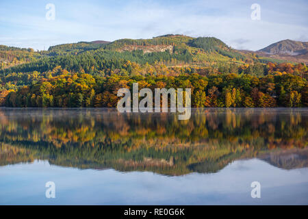 Early morning mist rising off Loch Faskally near Pitlochry, Perthshire, Scotland - Stock Image