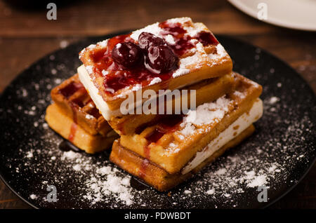 Viennese wafers with berry jam. Delicious and healthy breakfast. - Stock Image