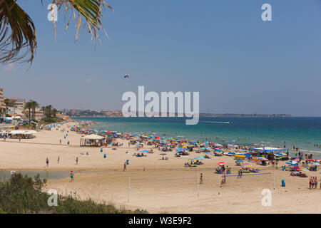 Mil Palmeras Costa Blanca Spain a small Spanish town on the beautiful Mediterranean coast south of Cabo Roig - Stock Image
