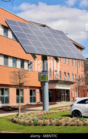 University of Central Lancashire solar panel in front of their school of Medicine and Dentistry. The meter shows the current power, total energy, and  - Stock Image
