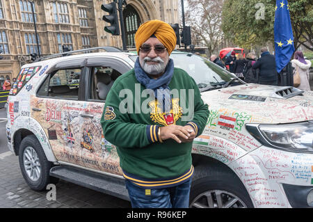 London, UK. 19th December 2018. The Turban Traveller, a Sikh with a film crew from Creative Concept Films in Delhi who arrived in London today after driving overland from Delhi, visiting 33 countries and around 50 cities in 150 days, covering 33,000km - over 20,000 miles. Later The Turban Traveller aims to drive the whole length of North and South America. Peter Marshall/Alamy Live News - Stock Image