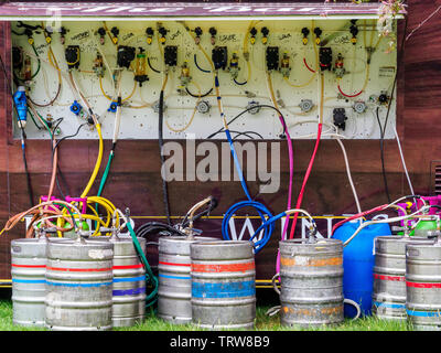 Festival Beer Stand - beer barrels connected to the pumps of a Festival Beer Stall UK - Stock Image