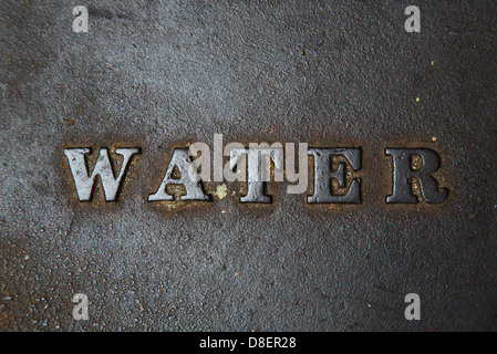 Word 'water' on a metal background - Stock Image