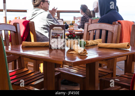 Diners eating outdoors at The Beachcomber Restaurant at Crystal Cove State Park California USA - Stock Image
