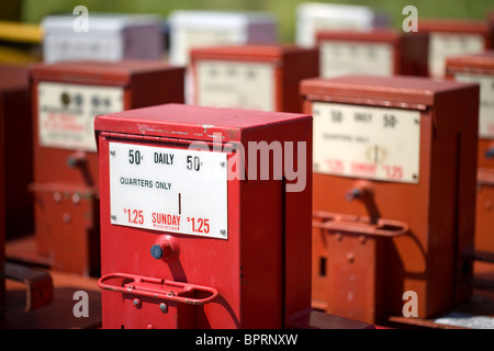 Rows of surplus newspaper boxes sit behind a building in Springdale, Ark. - Stock Image