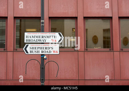 Street sign with directions to Hammersmith and Shepherds Bush, both located within the London Borough of Hammersmith and Fulham. - Stock Image