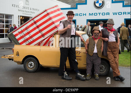 Chichester, West Sussex, UK. 13th Sep, 2013. Goodwood Revival. Goodwood Racing Circuit, West Sussex - Friday 13th September. Comedy and Sons Road Menders seen by their car and red and white tent. © MeonStock/Alamy Live News - Stock Image