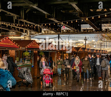 Southbank Winter Market (Christmas Market) under the Hungerford Bridge, London, UK. - Stock Image