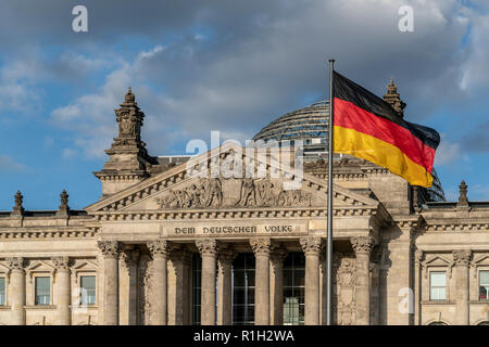 German National Flag in front of Reichstag building , Berlin - Stock Image