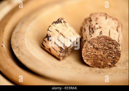 cork lids on wooden bowsl - Stock Image