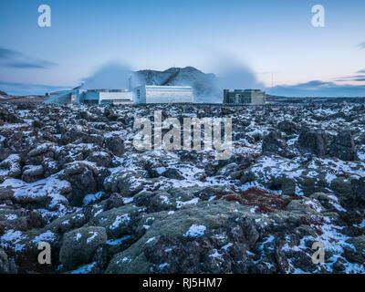 Power station on rocks - Stock Image