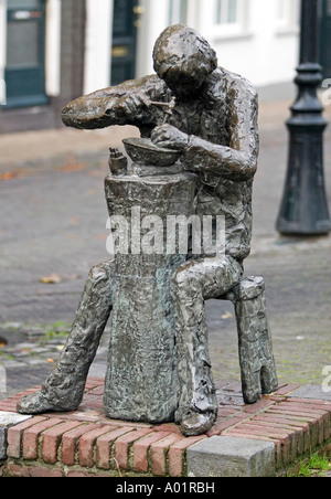 Sculpture of a silversmith making silver jewelery Schoonhoven, Southern-Holland, The Netherlands - Stock Image