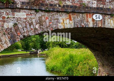 A lock gate viewed through bridge 54 on the Tardebigge Locks, Worcestershire - Stock Image