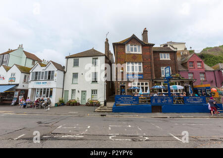Eating in Rock-A-Nore Rd,  Hastings, East Sussex, England , UK - Stock Image