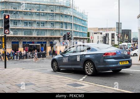 Uber taxi cab minicab on a UK street. - Stock Image