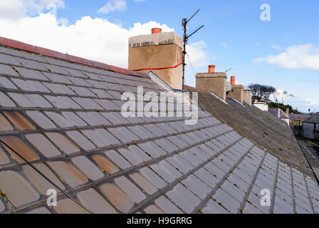 Roof tiles on a terrace row of houses. - Stock Image