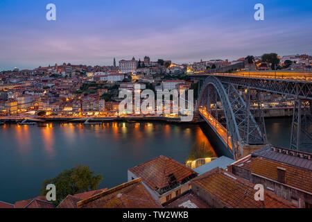 Porto at dusk, view across the Rio Douro and the Ponte Luis I bridge. - Stock Image