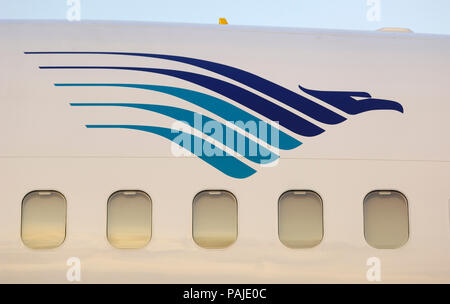 windows of Garuda Indonesia Boeing 737-800 parked in the static-display at the Singapore-Airshow 2010 - Stock Image