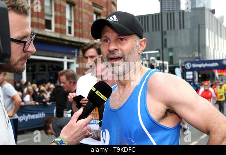 Ryan Giggs is interviewed after completing the Simply Health Manchester Run. - Stock Image