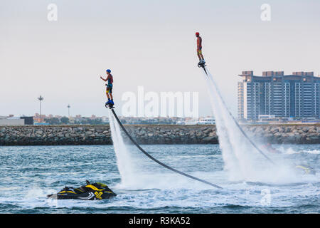 UAE, Dubai Marina. Jumeirah Beach water jet pack stunt flyers - Stock Image