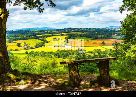 Sit in a bench to rest overlooking the wonderful English countryside. - Stock Image