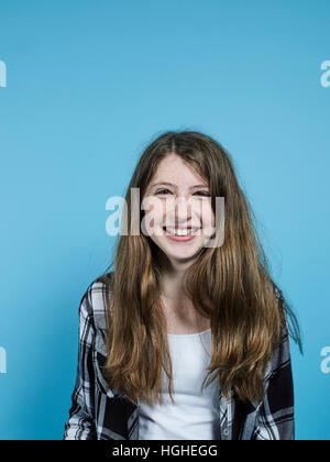 12yo female smiling studio portrait - Stock Image