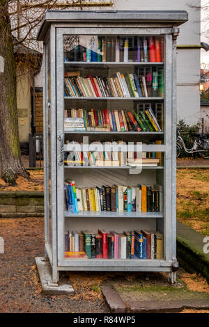 Goslar, Germany, December 11., 2018: Public lending library in the pedestrian zone for free lending of books for everyone - Stock Image