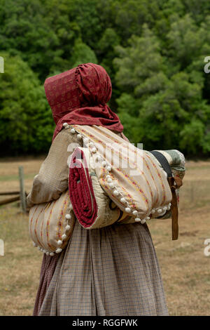 The side and back of an unidentified woman wearing a civil war costume - Stock Image