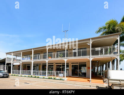Shops in an old building with rought-iron balcony along the foreshore, Cooktown, Far North Queensland, QLD, FNQ, Australia - Stock Image