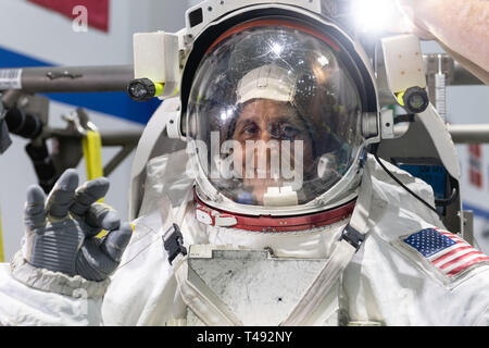 Boeing Commercial Crew Program astronaut Suni Williams in her spacesuit before entering the pool at the Neutral Buoyancy Laboratory for ISS EVA training in preparation for future spacewalks while onboard the International Space Station at the Johnson Space Center November 2, 2018 in Houston, Texas. - Stock Image