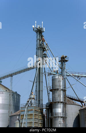 Communication and internet broadband antennas on rural farm cooperative feed and grain storage, handling, conditioning system tower, Whitelaw, WI - Stock Image