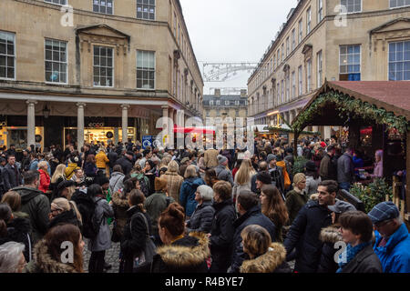 View of the crowds browsing the stalls down Bath Street opposite the Roman Baths on the opening weekend of the 2018 Bath Christmas market - Stock Image