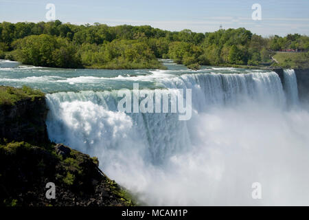 Niagara Falls, is the collective name for three waterfalls that straddle the international border between Canada and the United States; more specifically, between the province of Ontario and the state of New York. They form the southern end of the Niagara Gorge. - Stock Image