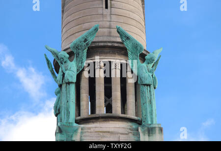 The statues on rooftop of church the Sacre Coeur . It is the monument in the municipality of Gentilly, France. - Stock Image