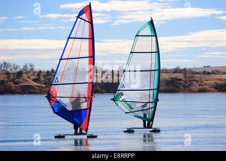 Littleton, Colorado - Two Ice Sailors wind surfing on a frozen Chatfield Reservoir - Stock Image