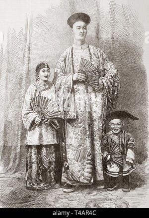 Zhan Shichai, 1841 – 1893.  A Chinese giant who toured the world as 'Chang the Chinese Giant' in the 19th century, his stage name was 'Chang Woo Gow'.   Seen here in 1865 with his wife, Kin Foo and his attendant dwarf, Chung.  Chang's height was reputed to be over 8 feet (2.44 m).  From The Illustrated London News, published 1865. - Stock Image