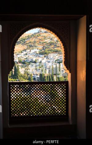Decorative Moorish Architecture window looking out on hillside village - Stock Image