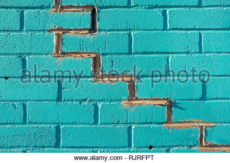 Crack in a brick wall, filled with new mortar. Birmingham, UK. - Stock Image