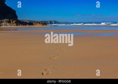 Fottprints on a deserted beach, Church Porth, Cornwall, UK - Stock Image