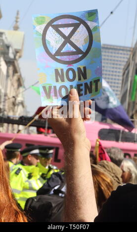 London, UK. 19th Apr, 2019. Climate placard seen during the demonstration.Environmental activists from Extinction Rebellion movement occupy London's Oxford Circus for a 5th day. Activists parked a pink boat in the middle of the busy Oxford Circus road junction blocking the streets and causing traffic chaos. Credit: Keith Mayhew/SOPA Images/ZUMA Wire/Alamy Live News - Stock Image