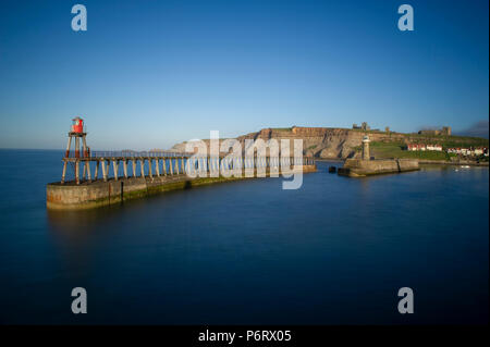 Whitby Harbour on a sunny summer evening on the Yorkshire coast - Stock Image