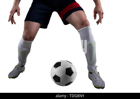 Soccer player ready to kick the soccerball at the stadium during the match. Isolated on white background - Stock Image