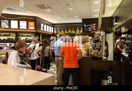 People in the airport cafe, the terminal interior, Pisa International Airport, Pisa, Tuscany, Italy Europe - Stock Image