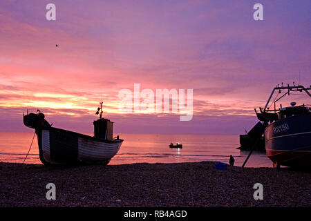 Hastings, East Sussex, UK. 7th Jan 2019. Very mild start to the day at sunrise on the Stade Fishermens beach as fishermen bring in the catch from a night fishing. Hastings has the largest beach-launched fishing fleets in Europe. - Stock Image