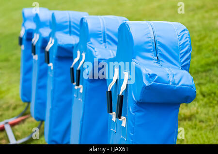 Football practice training dummies sled equipment for blocking and tackling. - Stock Image