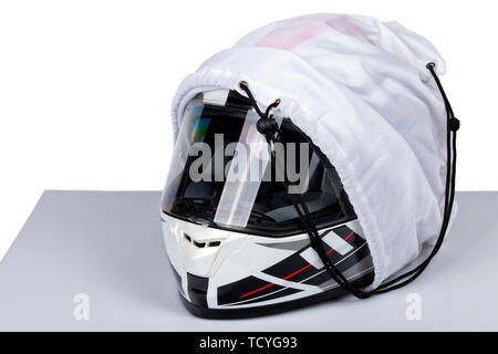 A white helmet full face of motorcycle inside its case isolated on white. - Stock Image